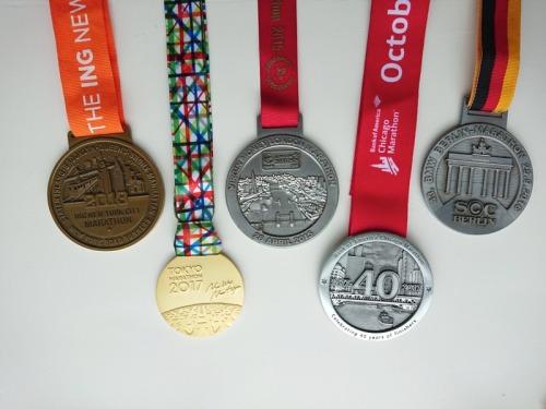 Mijn medailles van 5 World Marathon Majors.